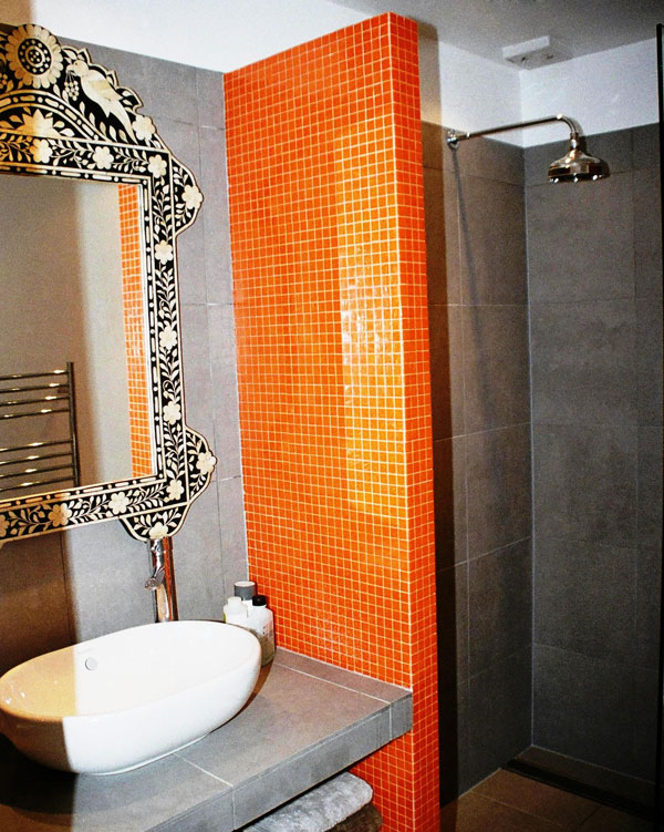 Orange tiled shower