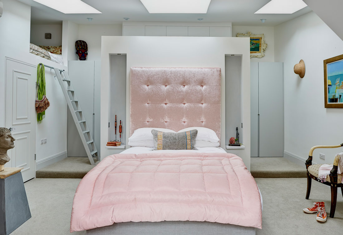 West London apartment master bedroom with bespoke cushioned headboard