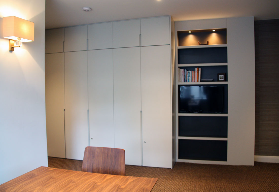 Wardrobes and lights in small apartment refurbishment