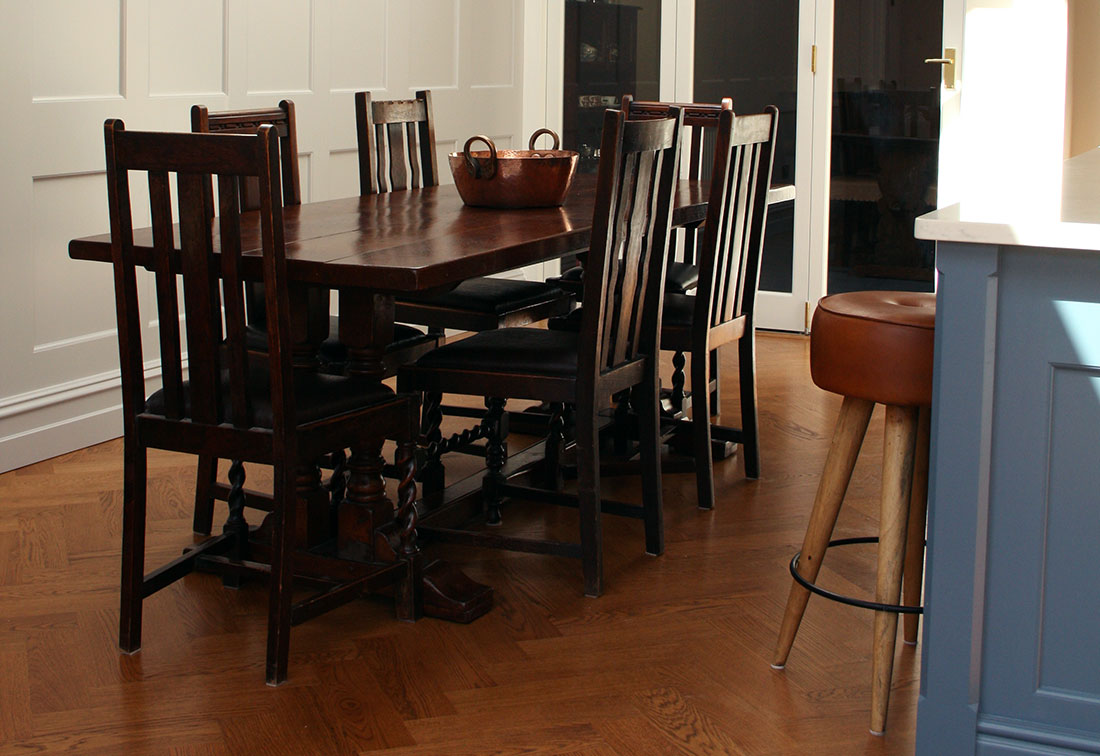 West London interior design of dining room with wood panels